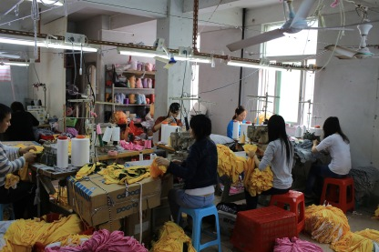 Puning, ?hina - March 18, 2013: the unidentified labors work in family business clothing workshop in Puning,Canton or Guangdong . China Manufacturing trend to move from coastal to inland area because the cost is growth